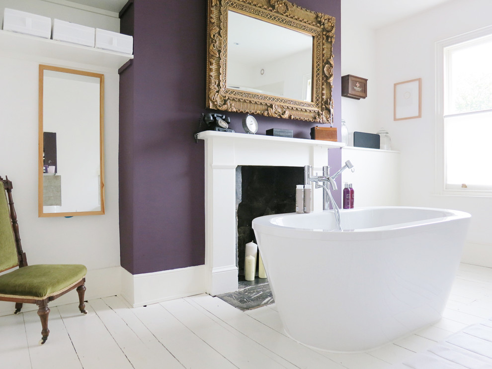 Inspiration for a victorian freestanding bathtub remodel in London with purple walls