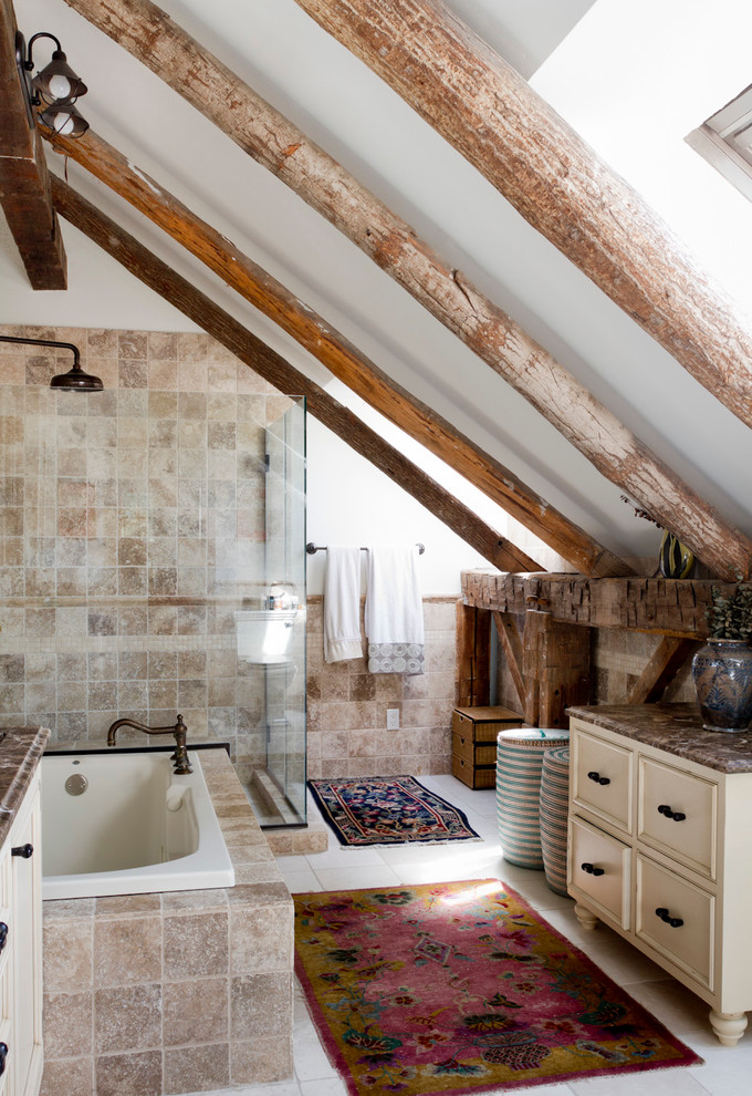 Example of an eclectic beige tile bathroom design in New York with white walls and brown countertops