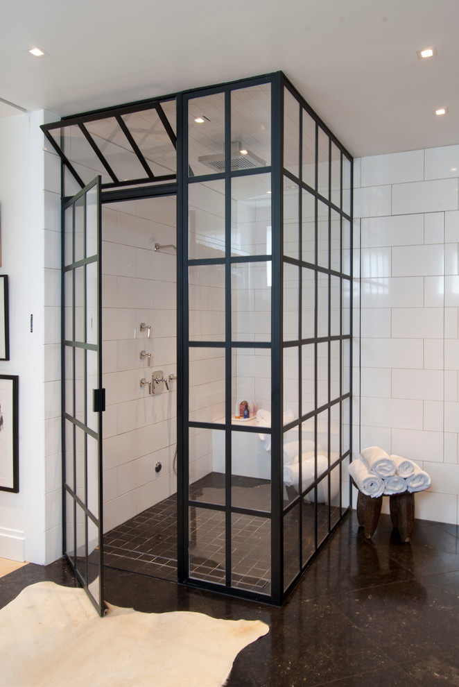 Example of a mid-sized trendy master white tile and stone tile limestone floor corner shower design in Other with an undermount sink, a two-piece toilet and white walls