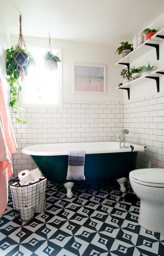 Inspiration for an eclectic master subway tile and black and white tile ceramic tile claw-foot bathtub remodel in Los Angeles with white walls