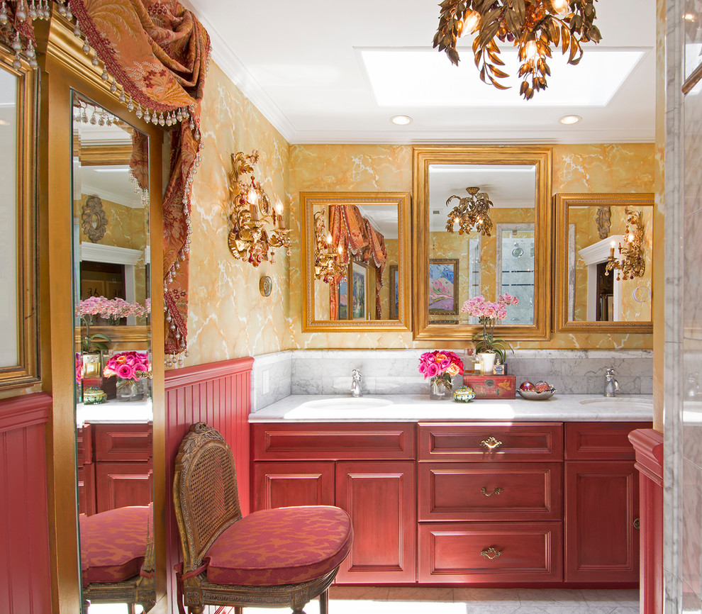 Inspiration for a victorian bathroom remodel in Los Angeles with recessed-panel cabinets, red cabinets, yellow walls and an undermount sink
