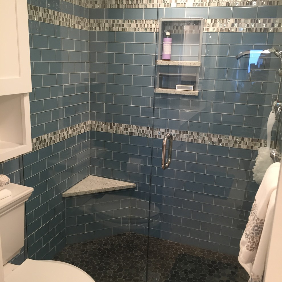 Mid-sized beach style master blue tile and subway tile pebble tile floor alcove shower photo in Miami with shaker cabinets, white walls and granite countertops