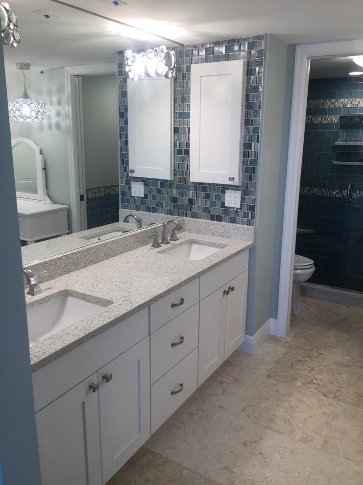 Mid-sized beach style master white tile and stone tile bathroom photo in Miami with shaker cabinets, white cabinets, blue walls, an undermount sink and quartz countertops