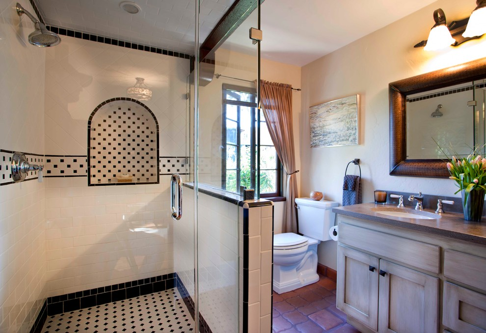 Example of a tuscan bathroom design in San Diego with an undermount sink
