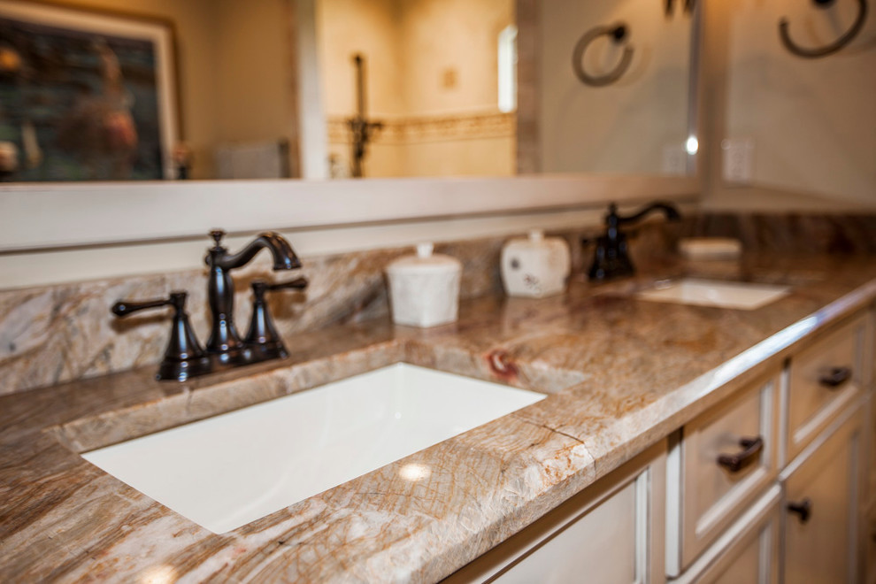 Mid-sized elegant master bathroom photo in Other with recessed-panel cabinets, white cabinets, beige walls, an undermount sink and marble countertops