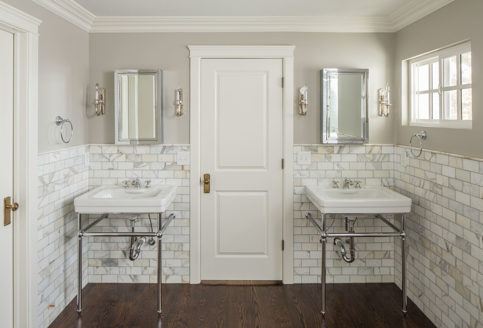 Example of a classic white tile and stone tile bathroom design in Salt Lake City with a console sink