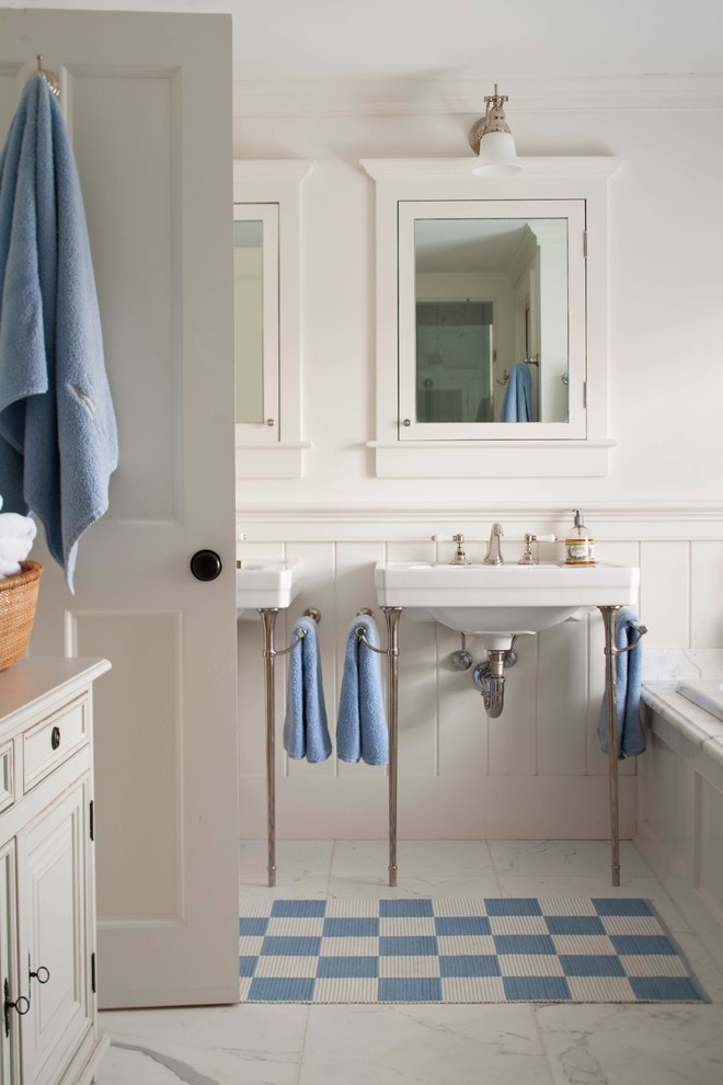 Example of a mid-sized classic master white tile marble floor drop-in bathtub design in Boston with a console sink, a two-piece toilet and white walls