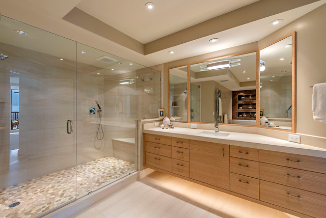 Trendy beige tile alcove shower photo in Dallas with flat-panel cabinets, medium tone wood cabinets, beige walls, an undermount sink and a hinged shower door