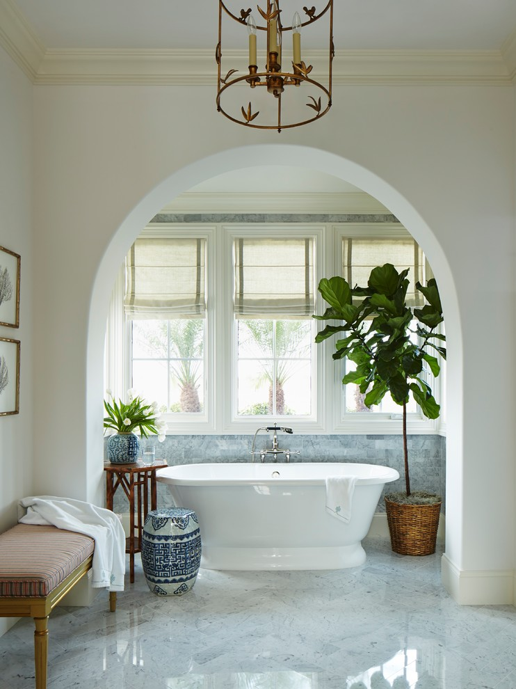 Inspiration for a huge tropical master gray tile and stone tile marble floor bathroom remodel in Miami with marble countertops, flat-panel cabinets, white cabinets, white walls and a console sink
