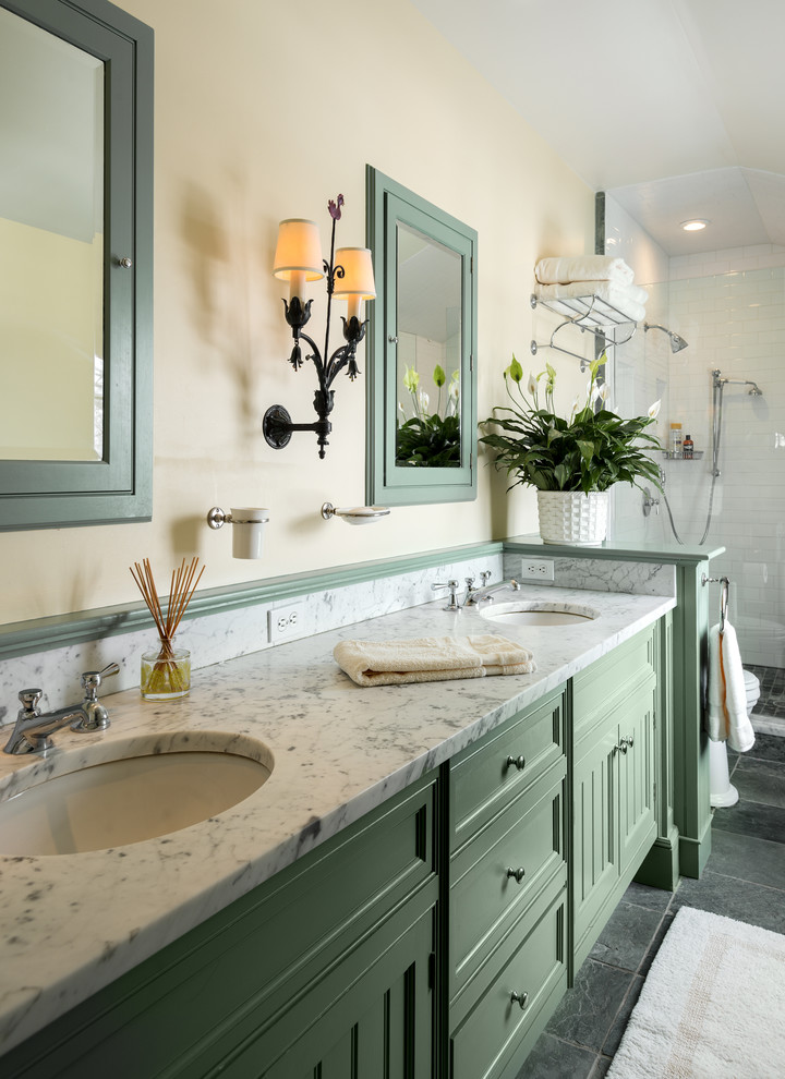 Inspiration for a country alcove shower remodel in New York with recessed-panel cabinets, green cabinets and beige walls
