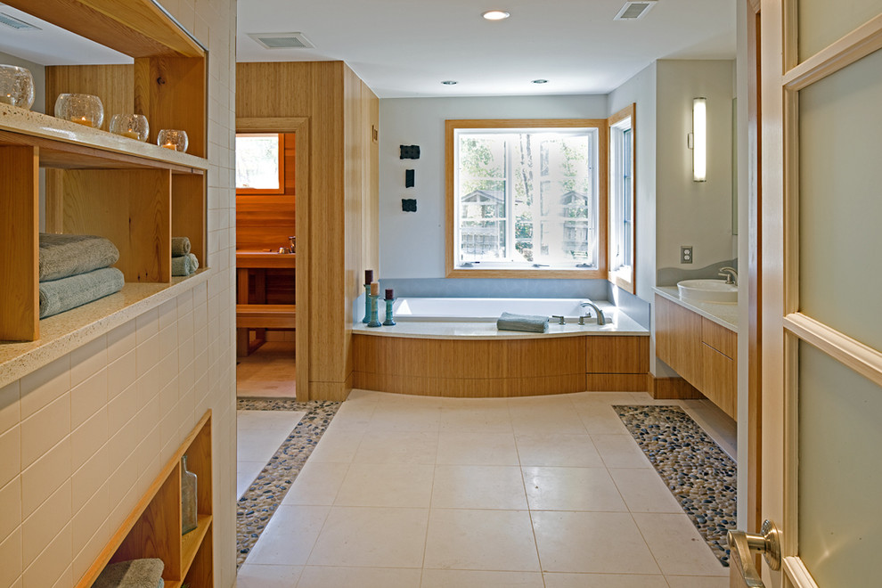 Inspiration for a mid-sized contemporary master white tile and stone slab pebble tile floor bathroom remodel in DC Metro with flat-panel cabinets, light wood cabinets, a one-piece toilet, blue walls, a vessel sink and solid surface countertops
