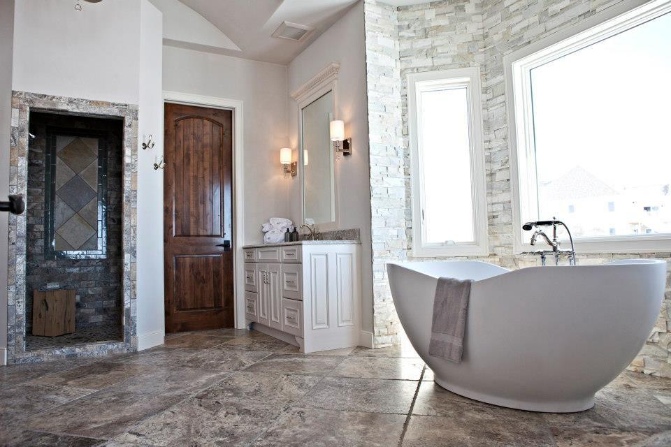 Doorless shower - rustic gray tile and stone tile doorless shower idea in Milwaukee