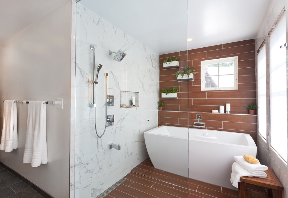 Example of a large trendy master gray tile and porcelain tile mosaic tile floor and brown floor bathroom design in DC Metro with flat-panel cabinets, light wood cabinets, white walls, an undermount sink, quartz countertops and a hinged shower door