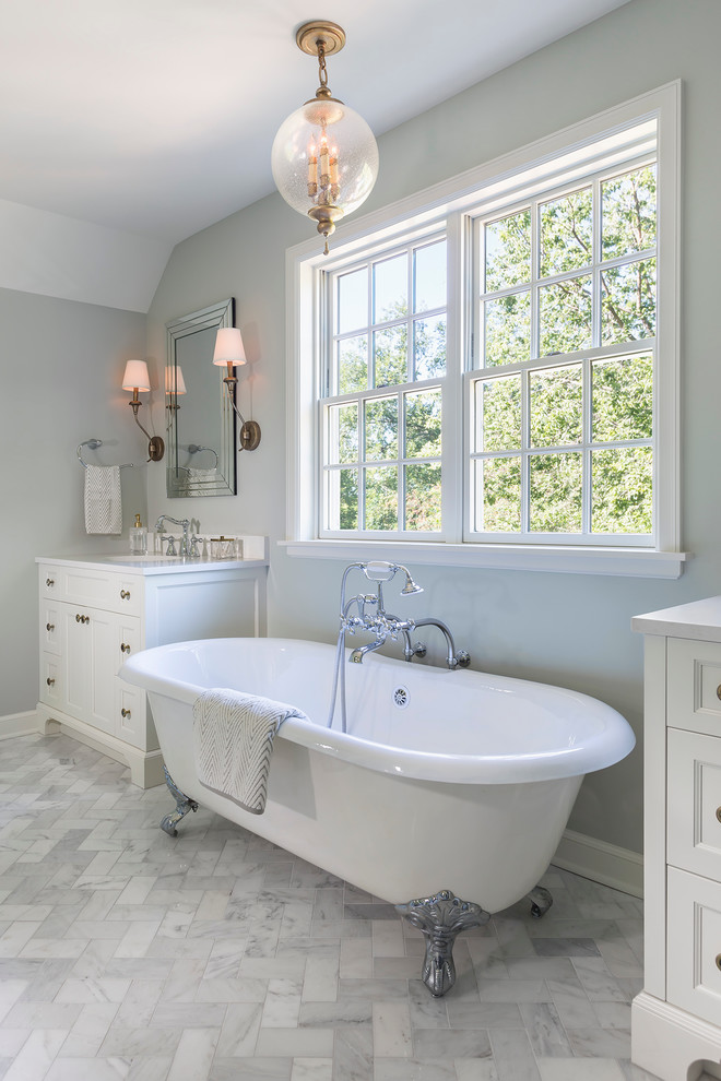 Large elegant master white tile and stone tile marble floor bathroom photo in Minneapolis with recessed-panel cabinets, white cabinets, quartz countertops, gray walls and a console sink
