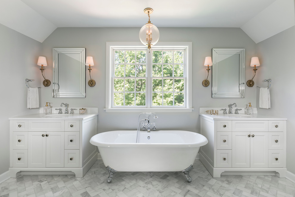 Bathroom - large traditional master stone tile and white tile marble floor bathroom idea in Minneapolis with recessed-panel cabinets, white cabinets, quartz countertops, gray walls and a console sink
