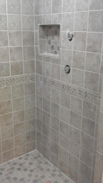 Neutral color diamond design tile work traditional for Neutral bathroom tile designs