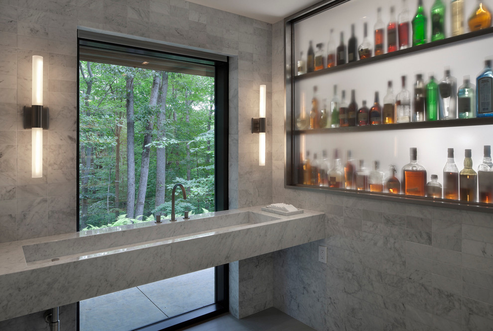Example of a large minimalist master gray tile and ceramic tile dark wood floor bathroom design in New York with open cabinets, white walls, a wall-mount sink and marble countertops