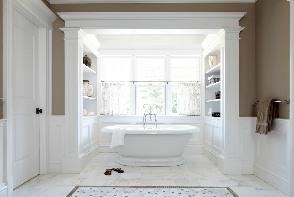 Freestanding bathtub - large victorian master white tile marble floor and white floor freestanding bathtub idea in New York with brown walls, open cabinets and white cabinets