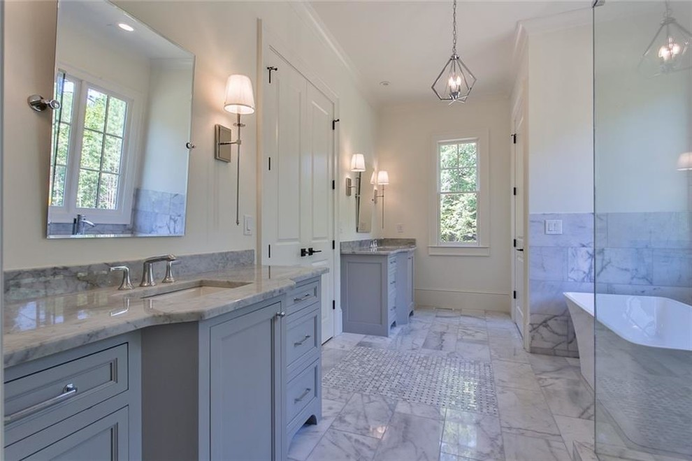 Bathroom - large transitional master gray tile and marble tile marble floor and gray floor bathroom idea in Atlanta with recessed-panel cabinets, gray cabinets, a two-piece toilet, white walls, an undermount sink, marble countertops, a hinged shower door and gray countertops