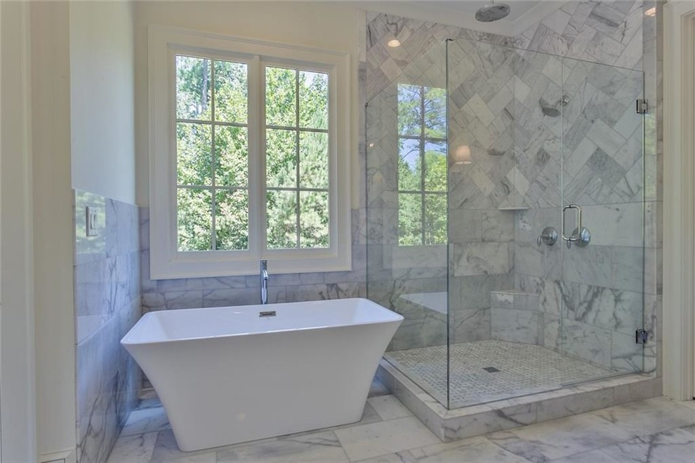 Inspiration for a large transitional master gray tile and marble tile marble floor and gray floor bathroom remodel in Atlanta with recessed-panel cabinets, gray cabinets, a two-piece toilet, white walls, an undermount sink, marble countertops, a hinged shower door and gray countertops