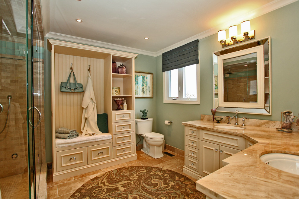 Example of a classic beige tile bathroom design in Toronto with an undermount sink, recessed-panel cabinets, beige cabinets, a two-piece toilet and beige countertops