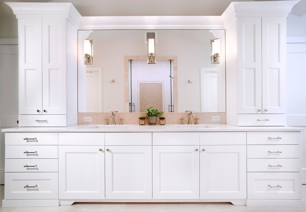 Inspiration for a mid-sized timeless master beige tile and stone slab porcelain tile and beige floor alcove shower remodel in Denver with shaker cabinets, white cabinets, beige walls, an undermount sink, quartzite countertops and a hinged shower door