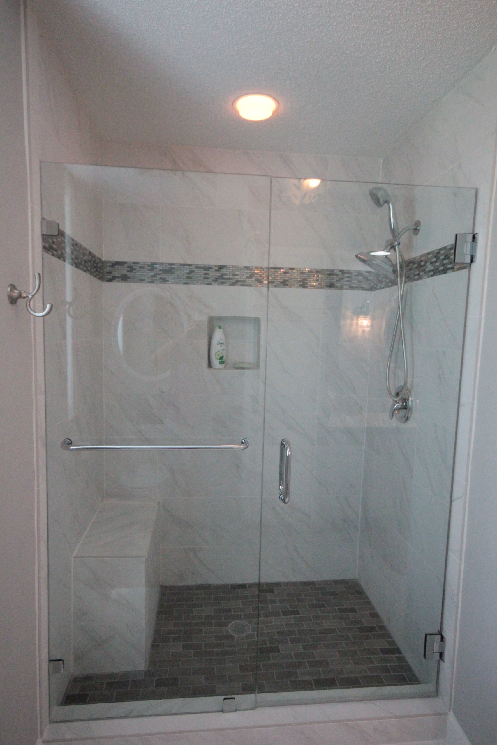 New shower with marble-look tile.