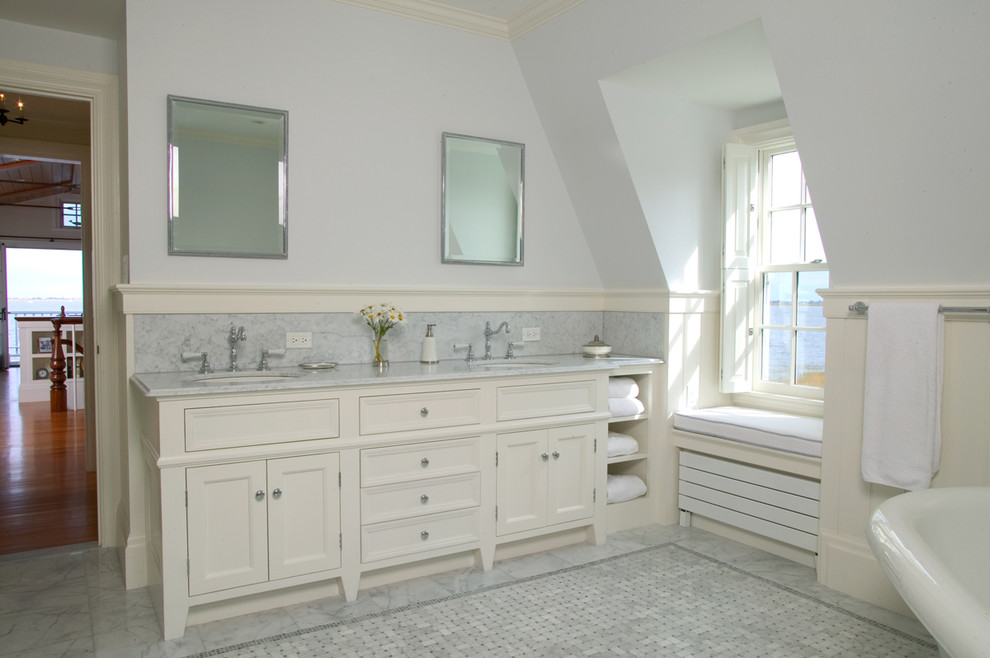 Large elegant master gray tile and marble tile mosaic tile floor and gray floor freestanding bathtub photo in Boston with an undermount sink, recessed-panel cabinets, white cabinets, blue walls, marble countertops and gray countertops
