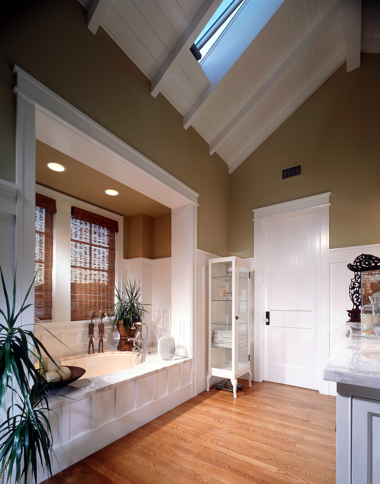Bathroom - traditional bathroom idea in Orange County with an undermount sink, white cabinets and an undermount tub