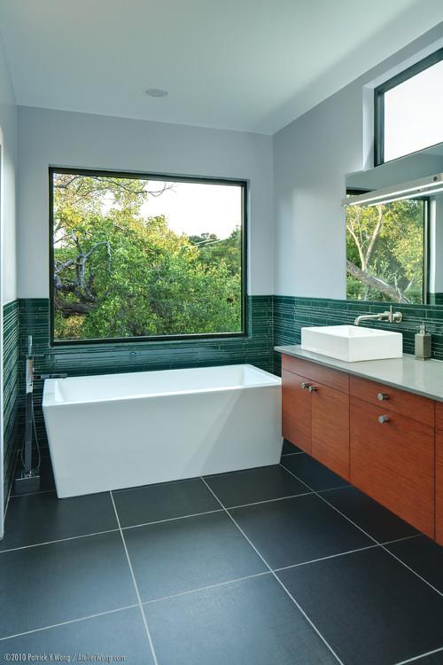 modern minimalist bathroom with unusual tub design