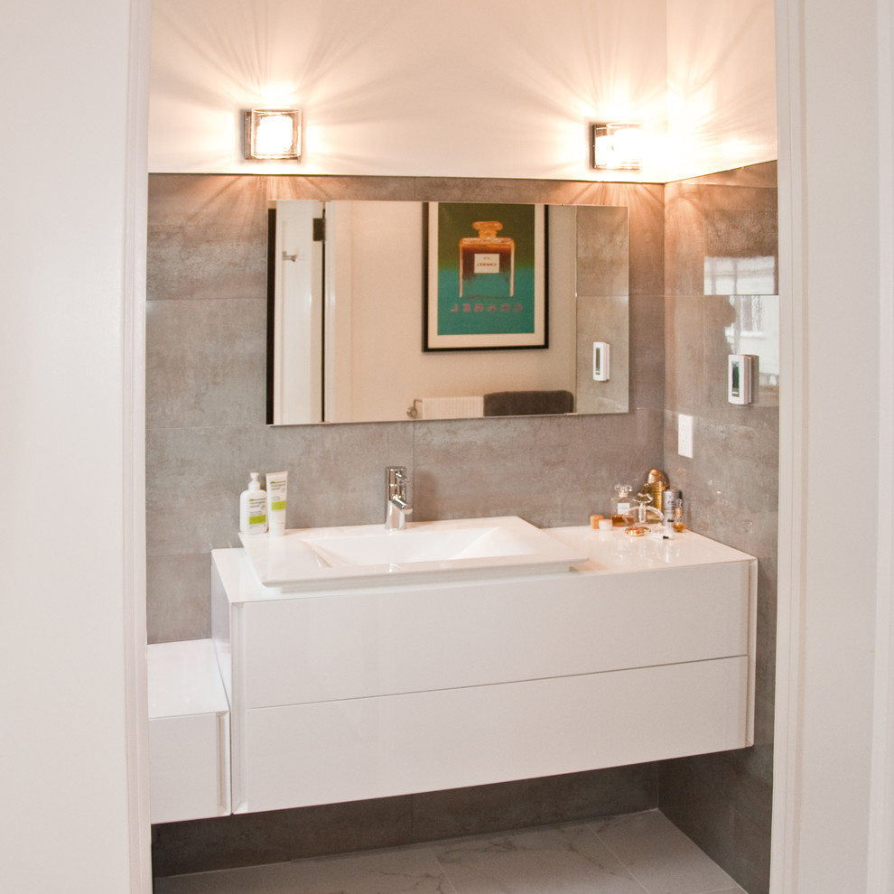 Mid-sized minimalist 3/4 porcelain tile and gray tile porcelain tile bathroom photo in San Francisco with a vessel sink, flat-panel cabinets, white cabinets, quartz countertops and white walls