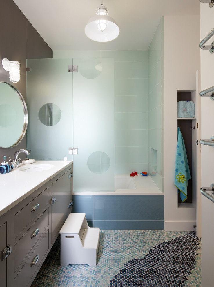 Example of a mid-sized trendy kids' mosaic tile floor tub/shower combo design in San Francisco with an undermount tub, a wall-mount sink, a hinged shower door and a floating vanity