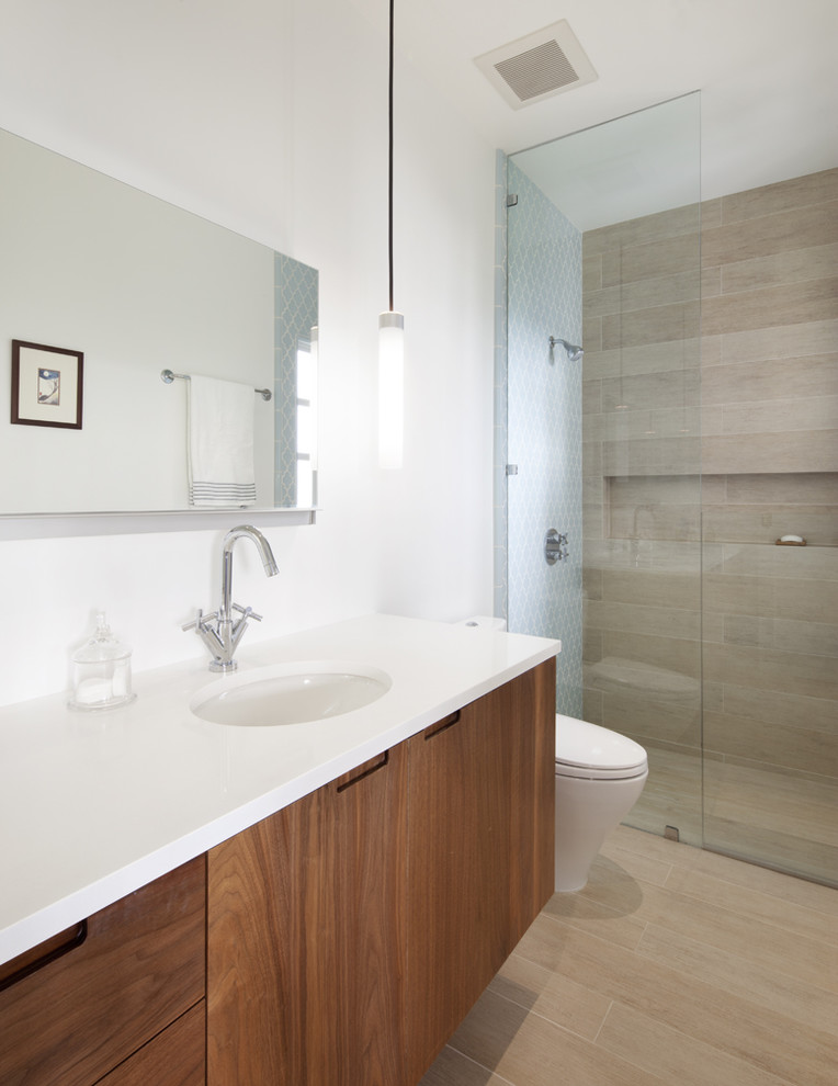 Walk-in shower - mid-sized contemporary master porcelain tile porcelain tile walk-in shower idea in San Francisco with flat-panel cabinets, medium tone wood cabinets, an undermount sink, a hinged shower door and a floating vanity