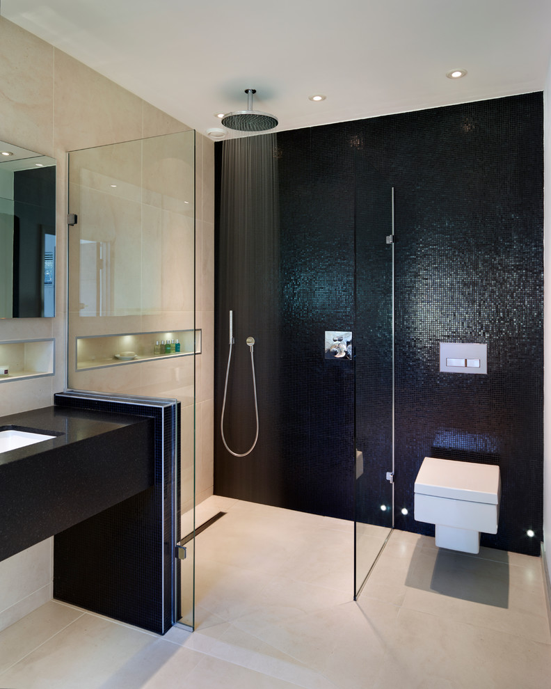 Trendy black tile and mosaic tile bathroom photo in Surrey with an undermount sink and a wall-mount toilet