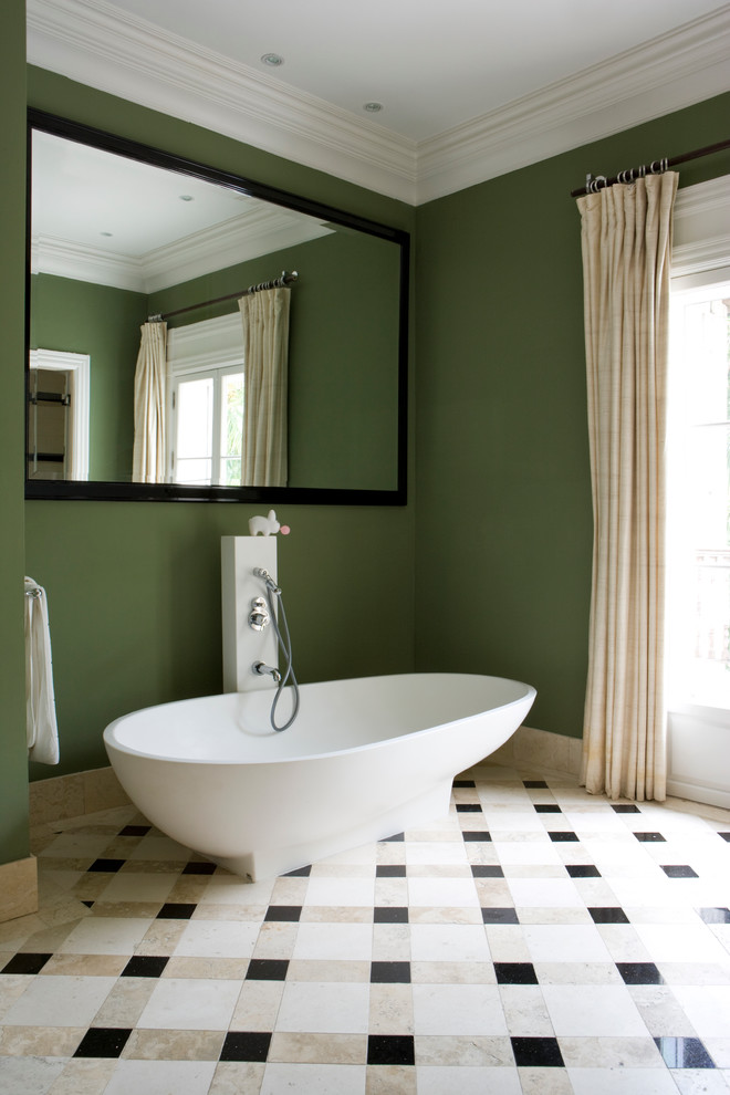 Trendy multicolored floor freestanding bathtub photo in Miami with green walls