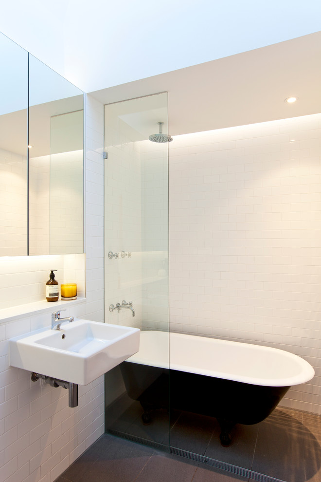 Inspiration for a contemporary subway tile claw-foot bathtub remodel in Sydney with a wall-mount sink