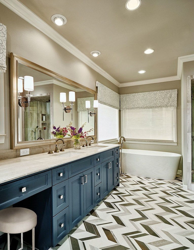 Freestanding bathtub - mid-sized transitional master black and white tile, gray tile and mosaic tile linoleum floor freestanding bathtub idea in Dallas with recessed-panel cabinets, blue cabinets, beige walls, an undermount sink, a two-piece toilet, granite countertops and beige countertops
