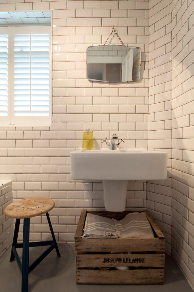Eclectic subway tile bathroom photo in London with a wall-mount sink
