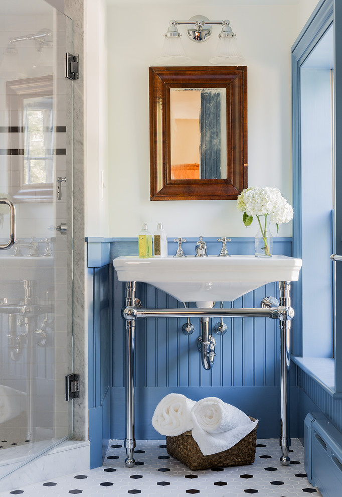 Elegant 3/4 corner shower photo in Boston with a console sink and blue walls