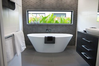North shore display home entertainer modern bathroom for Bathroom cabinets townsville