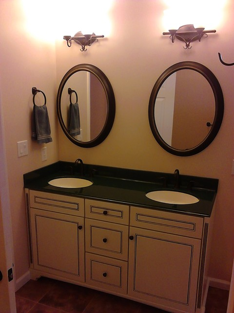 Elegant A Small Master Bath Was Enlarged By Stealing A Foot From The Laundry Room  A Small Freestanding Teak Bench Hidden Behind The Half Wall Facilitates Dog Baths! The Lighted Mirror, From The Tech Lighting Tigris Collection, Is Extremely