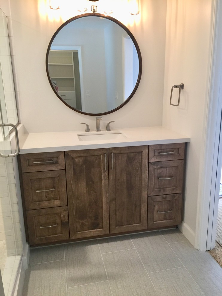 Inspiration for a small rustic 3/4 white tile and ceramic tile porcelain tile and beige floor corner shower remodel in Phoenix with shaker cabinets, medium tone wood cabinets, a one-piece toilet, white walls, an undermount sink, quartz countertops and a hinged shower door