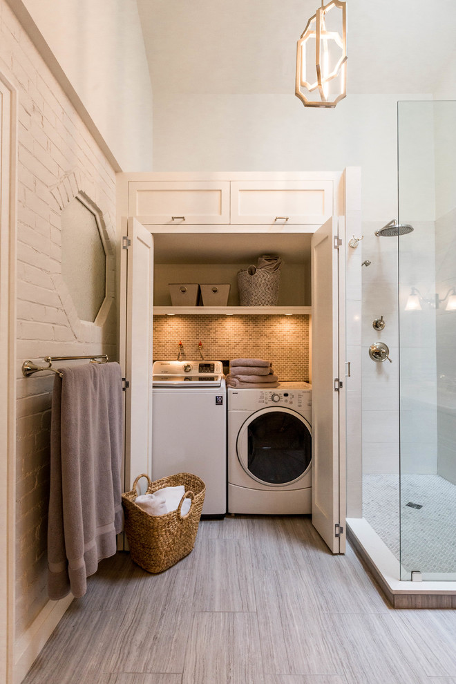 Mid-sized transitional beige tile and porcelain tile gray floor and porcelain floor bathroom photo in Toronto with shaker cabinets, black cabinets, a one-piece toilet, an undermount sink, onyx countertops and gray walls