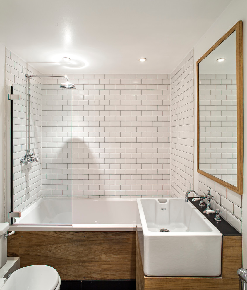Trendy subway tile tub/shower combo photo in London