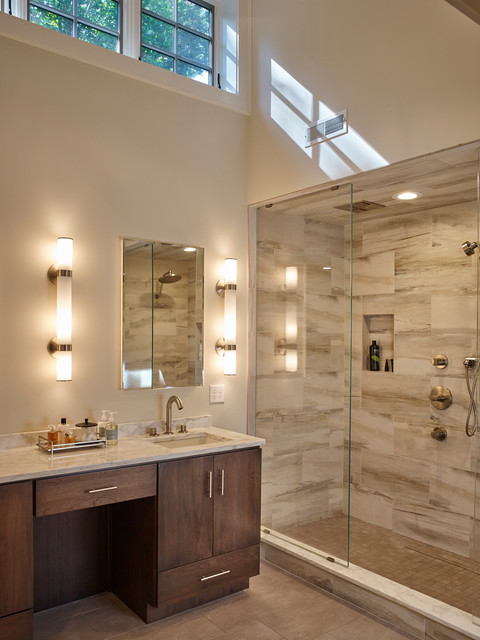 Example of a trendy master gray tile bathroom design in Boston with a console sink, flat-panel cabinets, dark wood cabinets, marble countertops and white walls