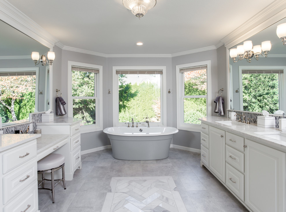 Example of a huge transitional master gray tile and porcelain tile marble floor and gray floor bathroom design in Portland with furniture-like cabinets, white cabinets, a two-piece toilet, gray walls, an undermount sink, marble countertops, a hinged shower door and gray countertops