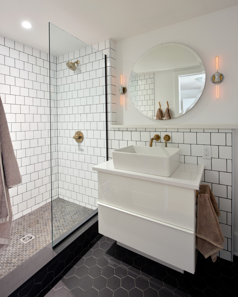 Inspiration for a mid-sized industrial 3/4 white tile and subway tile porcelain tile and black floor bathroom remodel in Ottawa with flat-panel cabinets, white cabinets, white walls, a vessel sink, solid surface countertops and white countertops
