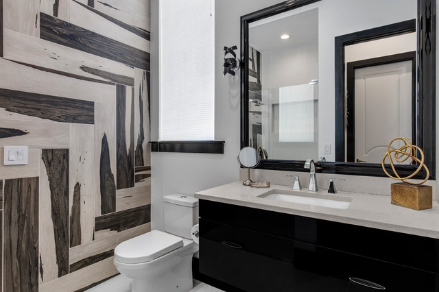 Alcove shower - small modern 3/4 black and white tile and glass tile porcelain floor alcove shower idea in Orlando with flat-panel cabinets, black cabinets, a two-piece toilet, white walls, a drop-in sink and engineered quartz countertops