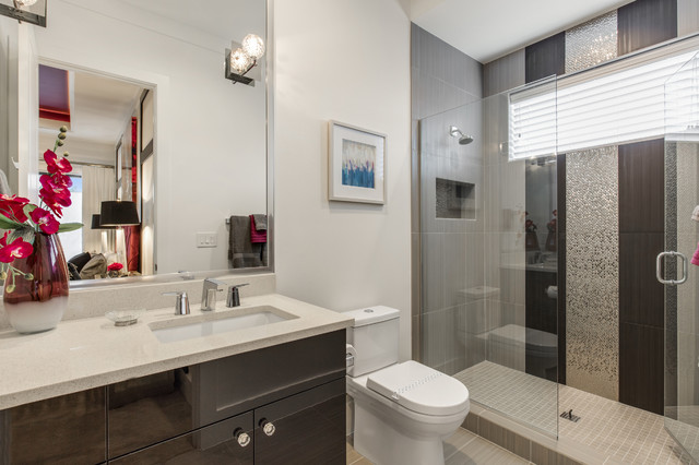 Example of a mid-sized trendy 3/4 black and white tile and porcelain tile porcelain floor alcove shower design in Orlando with flat-panel cabinets, dark wood cabinets, a two-piece toilet, white walls, a drop-in sink and engineered quartz countertops