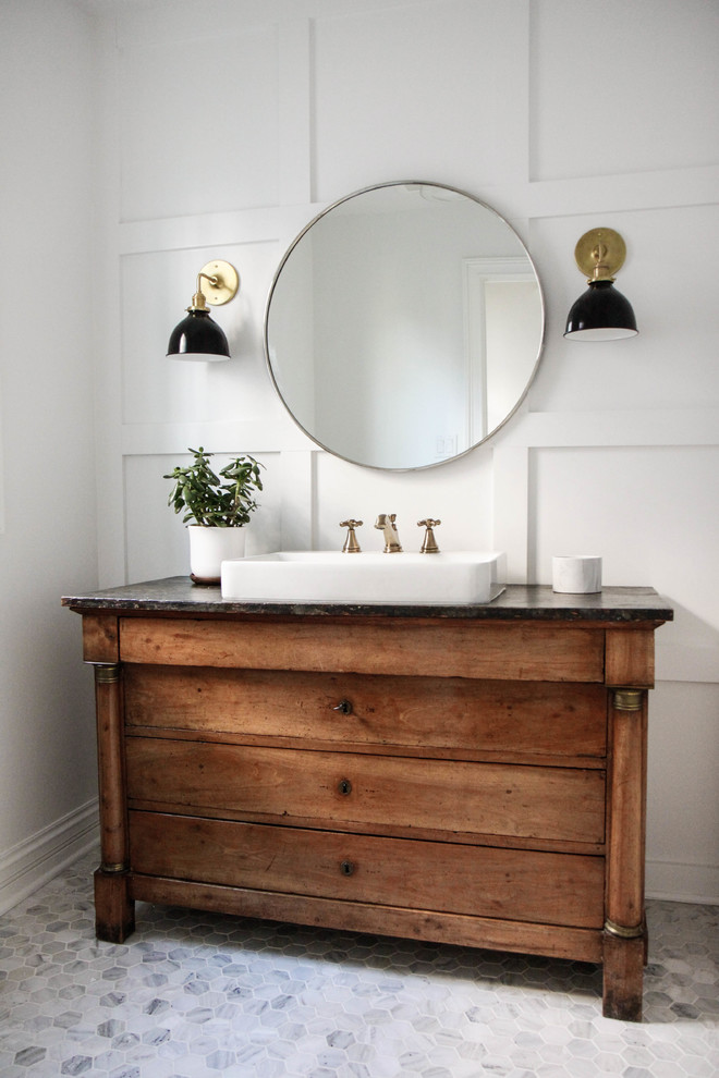 Inspiration for a mid-sized cottage 3/4 marble floor and gray floor bathroom remodel in Chicago with furniture-like cabinets, medium tone wood cabinets, white walls and a vessel sink